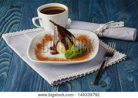 poached pear with chocolate and coffee on plate