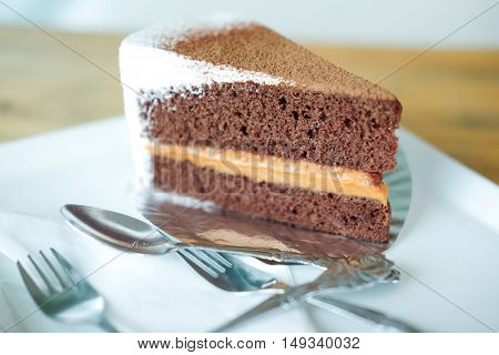 chocolate with milk tea cake on white dish