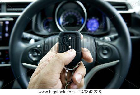 car key on hand inside the car
