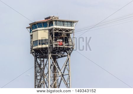 Barcelona Spain - August 17 2016: Cableway in the port of Barcelona. Red cabin parked.