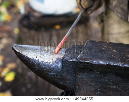Red Hot Iron Rod On Anvil
