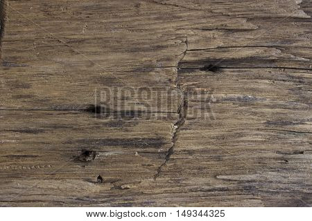 Brown wooden beam background with nail holes