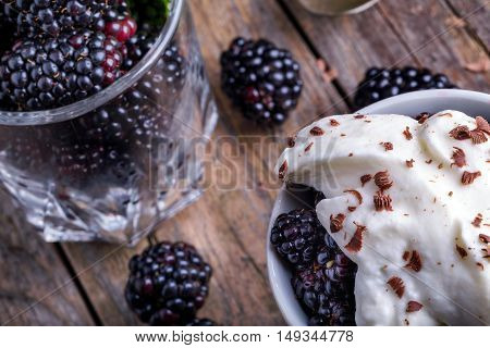 Cup Of Fresh Natural Blackberries With Whipped Cream