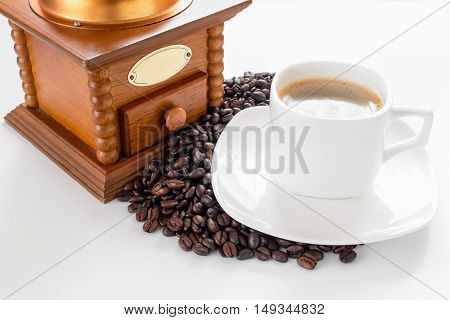 White cup of coffee and beans on a white background