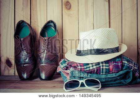Travel accessories. Shirts jeans hatsshoes ready for the trip
