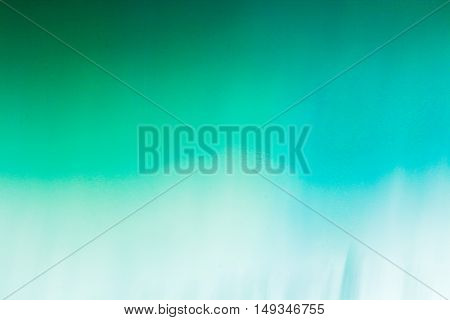 Abstract turquoise and white gradient background with motion blur.