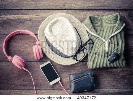 Travel accessories. Shirts hatssmart-phoneearphone wallets glasses car keys ready for the trip.