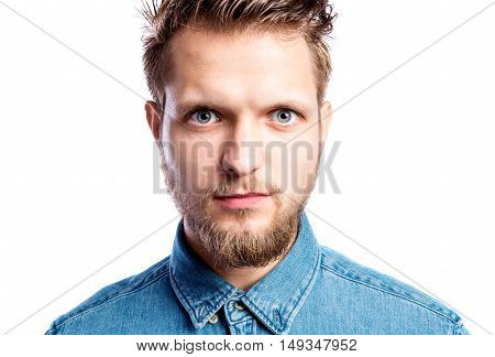 Close up of face of hipster man in blue denim shirt, studio shot on white background, isolated