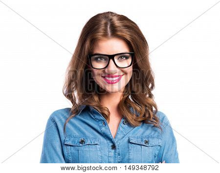 Young beautiful woman in blue denim shirt and trendy black eyeglasses, studio shot on white background, isolated