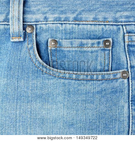 Front pocket on blue jeans close up