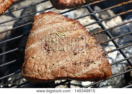 Grilled Beef Steak Cooking On Barbecue Grill