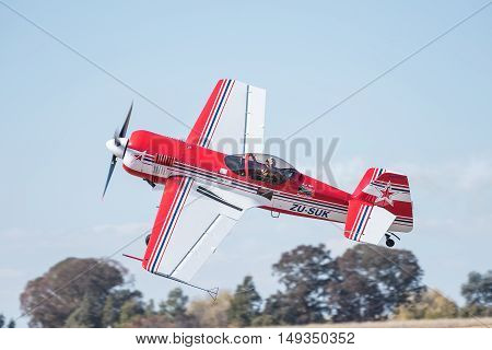 BLOEMFONTEIN SOUTH AFRICA - JULY 16 2016: A pilot in a Sukhoi SU-31 is a single engine aerobatic aircraft at a public display at the Tempe Airport in Bloemfontein