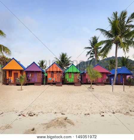 colorful bungalows on the beach. Tropical getaway paradise
