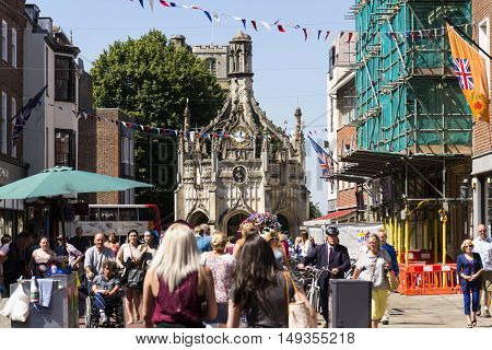Chichester, United Kingdom - August 12: People Walk On Street In Front Of The Chichester Cross On Au