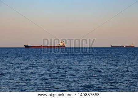 empty cargo ship in the sea On the Sunset