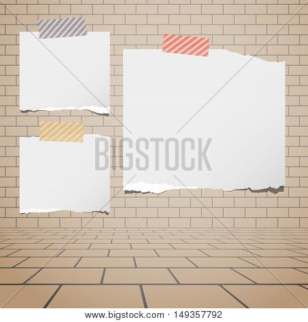 Torn white blank paper sheets stuck on brown brick wall.