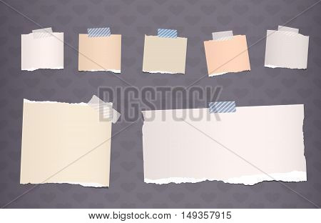 Ripped brown notebook, note paper stuck on dark gray background.