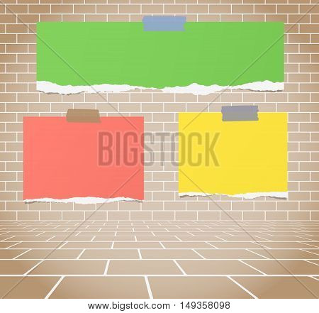 Torn colorful blank paper sheets stuck on brown brick wall.