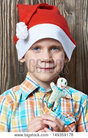 Little Boy In Red Cap With Christmas Cookies