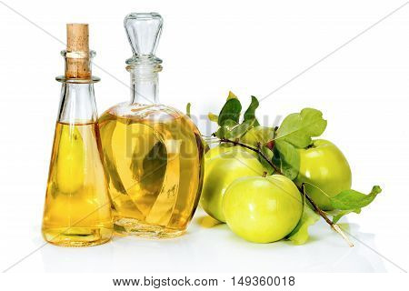 Apple Cider Vinegar In A Glass Vials And Green Apples