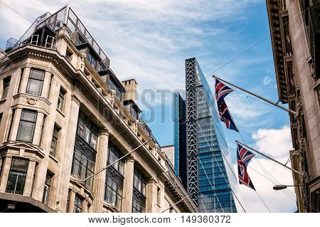 LONDON UK - AUGUST 21 2015: Street in the city of London with the contrast between historical buildings and new skyscrapers