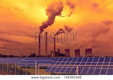 Thermal power plant with solar panels, sunset sky