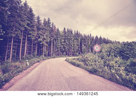 Retro Toned Road With Speed Limit Sign