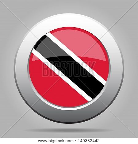metal button with the national flag Republic of Trinidad and Tobago on a gray background
