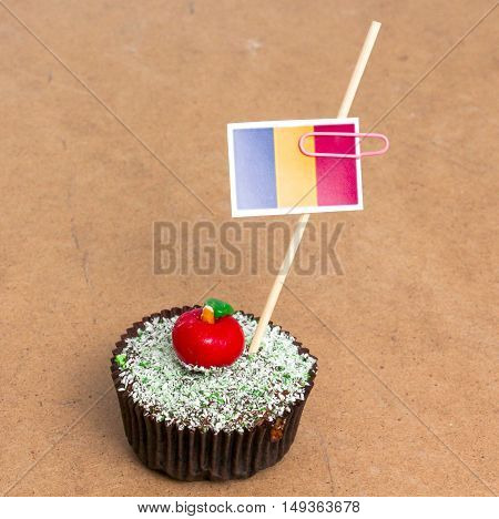 Flag of Chad. Apple Cupcake with red apple shape bonbon on the top