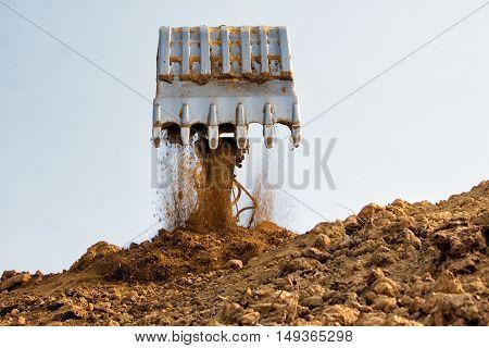 Excavator bucket on sky Industrial excavator machine