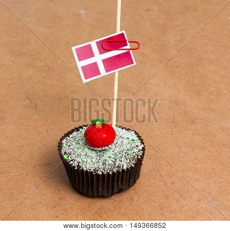 Flag of denmark. Apple Cupcake with red apple shape bonbon on the top