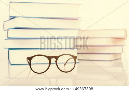 Eyeglasses with stack of book retro tone