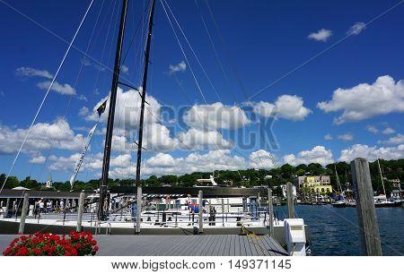 HARBOR SPRINGS, MICHIGAN / UNITED STATES - AUGUST 1, 2016: Sailboats are moored at the Harbor Springs Municipal Marina.