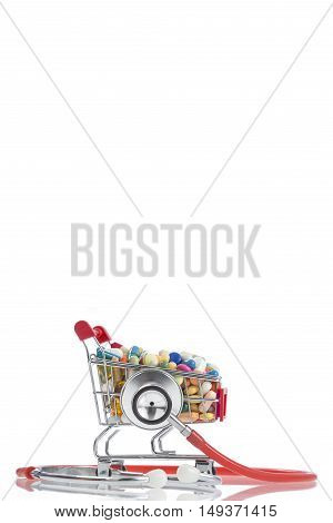 Stethoscope and shopping cart on a white background
