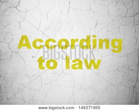 Law concept: Yellow According To Law on textured concrete wall background