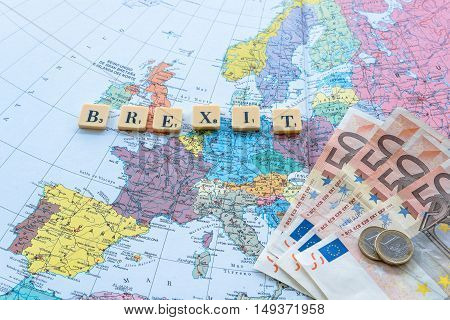 London UK - June 12 2016: Brexit word with euro money on european map. The United Kingdom European Union membership referendum on 23 June 2016