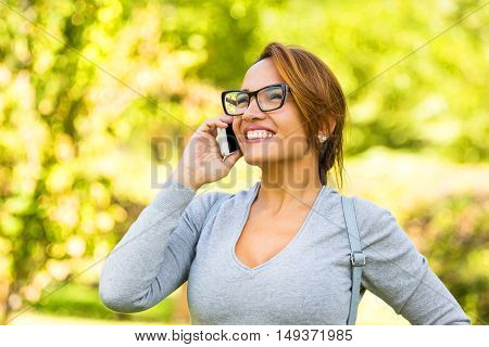 Beautiful Latin Woman Talking On The Phone And Smiling