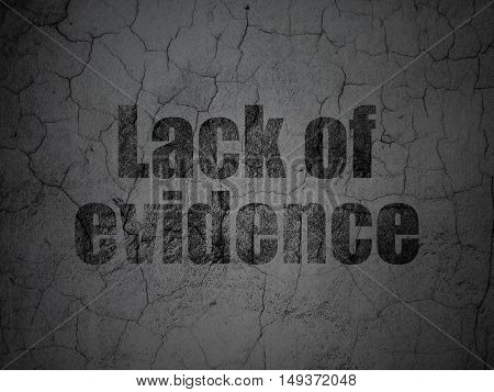 Law concept: Black Lack Of Evidence on grunge textured concrete wall background