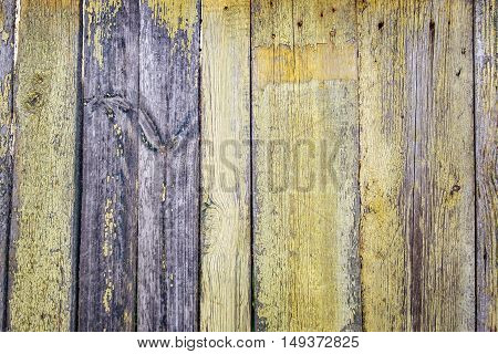 Old wood plank. Gloomy wooden rustic background peeling old yellow paint