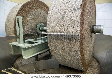 A grinding stone inside an olive oil factory in Mendoza, Argentina