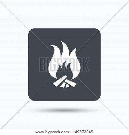 Fire icon. Blazing bonfire flame symbol. Gray square button with flat web icon. Vector