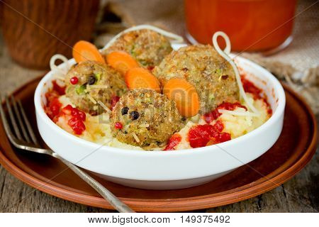 Funny Halloween party food - meatloaf rats in potatoes with bloody tomato sauce