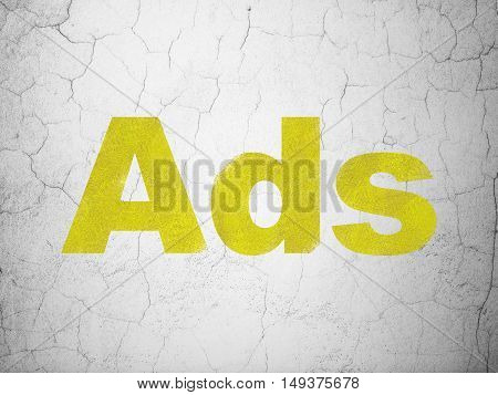 Advertising concept: Yellow Ads on textured concrete wall background