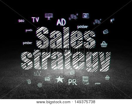 Marketing concept: Glowing text Sales Strategy,  Hand Drawn Marketing Icons in grunge dark room with Dirty Floor, black background