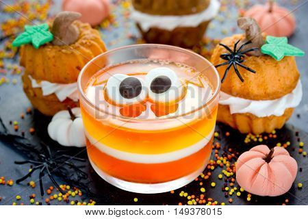 Funny treats for kids for Halloween - jelly candy corn pumpkin cakes different sweets