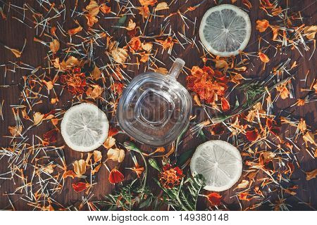 background cup of slices of lemon and flowers Marigolds
