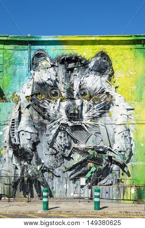 Lisbon Portugal - 17th July 2016: Raccoon Lisbon city street art. The famous Portuguese artist Bordalo II making his works with recycled materials that he found on streets