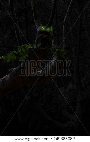 Tree with a large mouth and glowing eyes in the mystery forest
