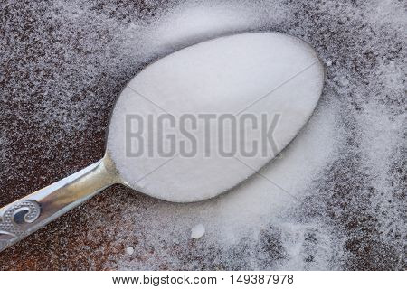 Baking soda on and around the spoon. Also called sodium bicarbonate