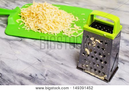 The Cut Cheese On A Green Board